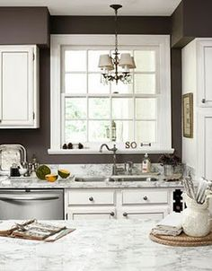 dark brown walls + white cabinets - Love this with light stone countertops - Cute mini chandelier adds a lil whimsy Diy Dining Table, Kitchen Dining, Kitchen Decor, Kitchen Colors, Kitchen White, Nice Kitchen, Kitchen Cabinets, Brown Walls Kitchen, Beautiful Kitchen
