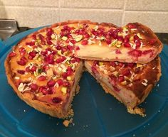 Raspberry and white chocolate Tart with pistachio nut and pomegranate topping.