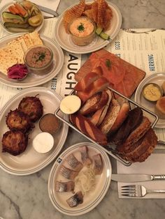 """""""Joyous spread at Russ& Daughters: knishes, schmaltz herring, lox, latkes. Not forgetting chopped liver"""" - Nigella Lawson"""