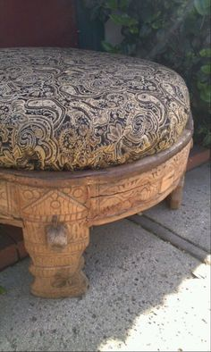 This is an 1800's antique grain mill ottoman from Rajasthan, India. They are called chakkis and were originally used as a base for household stone flour mills.  It is hand carved wood with m...