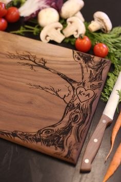 Personalized Cutting Board Newlyweds Christmas Gift Bridal Shower Gift Wedding Gift Engraved Love Tree (Item Number MHD20019) by braggingbags on Etsy https://www.etsy.com/listing/201092599/personalized-cutting-board-newlyweds