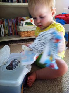 Homemade baby toy repurposing baby wipes container and fabric scraps