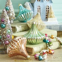 I love vintage looking glass ornaments and the little trees....and glitter houses of course (c: