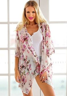 Pink Floral Cardigan - This half sleevefloral cardigan makes a great addition to any outfit. It can be added to a fun, causal summer outfit or matched with a cute skirt and sandals for a more dressed up look.