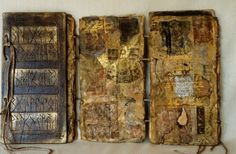 Inga Hunter- A book with carved wood covers and thick, layered pages made from handmade paper and silk, with etchings and paint. Stitched together by sandwiching the binding threads between the layers of paper.