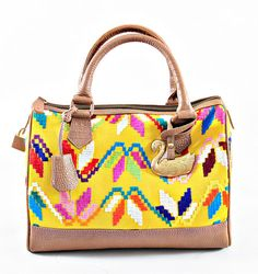 http://www.ebay.co.uk/itm/BLINK-BATIK-ANTIK-Geometric-Designer-Leather-Tote-Speedy-Bag-IKAT-TRIBAL-Bold-/261225298938?pt=US_CSA_WH_Handbags&hash=item3cd23dbbfa