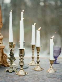 Brass candlesticks | Warmphoto | see more on: http://burnettsboards.com/2015/02/winter-coming-game-thrones-wedding/