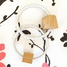 White Braided Leather Bracelet Set with Wood Cubes These two bracelets are so modern and unique! Two large, wooden cubic beads are set on a rounded white leather chain. They just simply slip on your hand, there's no closure/opening. Excellent condition! Anthropologie Jewelry Bracelets