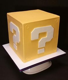 """Connor loved his Super Mario Bros birthday cake so much last year, that he requested another one this year too! He loves the mystery boxes in the game, so I made this 8"""" cube of, well…CHOCOLATE! He is such a fan of it, that the cake, Swiss..."""