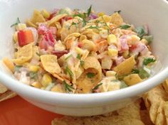 This salad has corn, green & red pepper, Bermuda onion, cheddar cheese and mayo - and - right before serving - you add Frito Corn Chips!