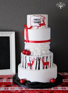 """May all your Christmases be white! Hand painted reindeer silhouettes create a modern and graphical take on a holiday cake    -- """"Where sweet dreams come true"""" http://www.facebook.com/TLBCakes"""