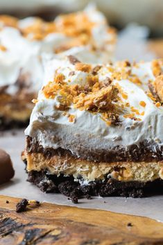 This Butterfinger Chocolate and Peanut Butter Lush is almost too good to be true. This no-bake dessert recipe combines a chocolate cookie crust with layers of peanut butter cream cheese, whipped topping, chocolate pudding, and crushed Butterfinger candy bars. Click here to see how you can make this crispety, crunchety, peanut-buttery treat for yourself.