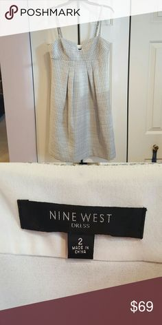 Very Pretty Cocktail Dress by Nine West Light grey with silver. This nicely structured dress won't hug you in all the wrong places it falls away from the body perfectly. I love the metal detail as the straps for a soft edge. Never worn just doesn't fit me. Nine West Dresses