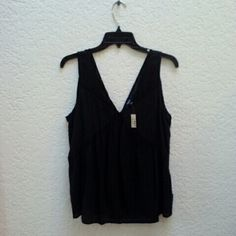 NWT Madewell Black Silk Deep V Tank New with tags Madewell tank, size medium, in perfect condition. The 'shell' is 100% silk and the 'contrast' is 100% polyester. It is semi sheer.. just barely sheer. And super flowy. Deep V neck and back. Please ask any and all questions before purchasing. Thanks! Madewell Tops