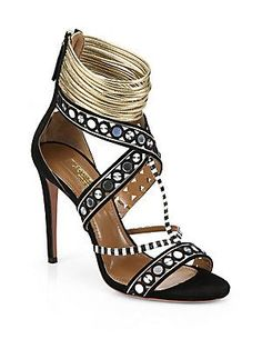 Details A corded metallic leather ankle wrap and back zip finish these spectacular sandals comprised of suede, cord-trimmed silver discs and striped, snake-embossed leather trim.Covered heel, 4
