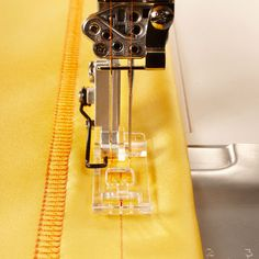Pfaff - Clear Coverstitch Overlock Foot. With the Clear Coverstitch foot, you can see your fabric and marked line under the foot as you sew.