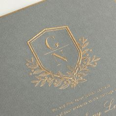 Vera Wang Engraved Gold Bordered Light Grey Wedding Invitation