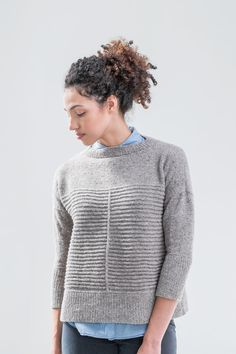 Prime is a textural riff on our favorite boxy pullovers. Welts on the lower torso are halved by a narrow vertical element, while the yoke is in clean stockinette fabric. Exaggerated drop shoulders and just a hint of A-line shaping through the torso finesse the roomy fit, and the light warmth of Loft makes this …