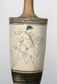 """Attic White-Ground Lekythos. Date: about 460 B.C. White lekythos (Class ATL). Youth in chlamys and petasos with drawn sword, striding to right. Above, band of running leftward meander. Inscription """"Euaion kalos Aischylo""""."""