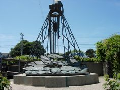 """Cape Cod  """"The Provider"""" sculpture at Chatham Fish Pier features fish indigenous to Chatham caught in the net"""