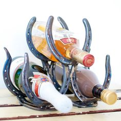 Homemade Horseshoe Wine Rack! How fun!