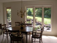 Dining room view of a pondless waterfall backyard.