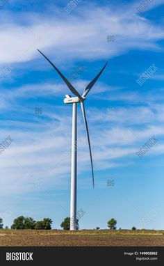 Wind turbine in a Kansas field with clouds