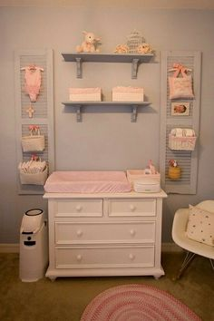 These are the shutters in my girls' nursery. We've loved having the diaper storage off of the changer surface, but close by.