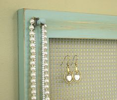 Jewelry Holder Organizer Frame Wall Hanging Vintage Pale Jade Framed Jewelry Holder Earrings Necklaces Knob. $24.00, via Etsy.