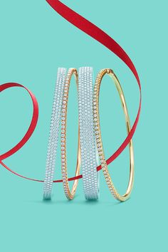 Tiffany Metro bangles with diamonds, from left: three-row bangle in 18k white gold, bangle in 18k rose gold, five-row bangle in 18k white gold, and bangle in 18k yellow gold. #TiffanyPinterest