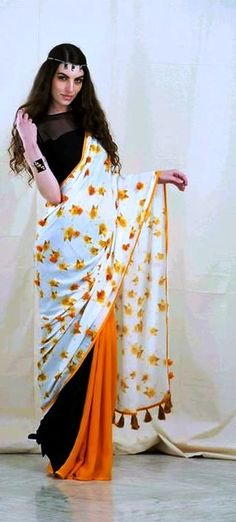 Blossom like never before with this beautiful saree from Kanelle by Kanika Jain in orange and black! It is light and easy to carry! Price for saree is 14000/- and blouse is 2600/-