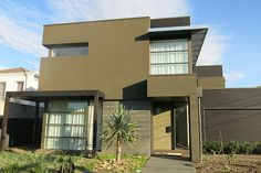 Modern Style House Plan - 4 Beds 2.5 Baths 3389 Sq/Ft Plan #496-17 Front Elevation - Houseplans.com