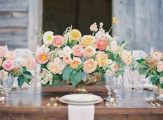Reception flower tablescape inspiration in gold containers (David Austin roses, Icelandic poppies [no orange] ranunculus, and jasmine) Not as bright though, a bit more pastel. Would love to add cafe au lait dahlias, white anemone, and blush and white cabbage roses as well.