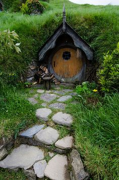 Steps to the Orange Door, Matamata, New Zealand (by Arbron). garden houses hobbit hole It's a beautiful world Fairy Houses, Play Houses, Garden Houses, Garden Cottage, Casa Dos Hobbits, Beautiful World, Beautiful Places, Root Cellar, Fairy Doors