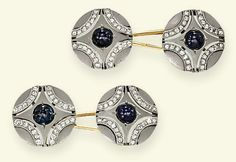 A PAIR OF SAPPHIRE AND DIAMOND ART DECO CUFFLINKS  Each circular openwork panel with sapphire cabochon centre to the frosted ground with diamond-set curved line quarters, mounted in platinum and gold, circa 1925, 1.5 cm diameter, in fitted brown leather Weil case