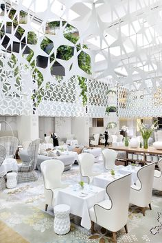 Suspended 2d screen across the top datum, with downplayed lighting to make up for cost? Film to mimick on glass? Mandarin oriental bcn by patricia urquiola