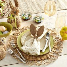 Create a cheery and tasteful setting for your Easter brunch with ivory lace napkins, natural-looking woven placemats, and sage green accents.
