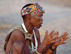 Africa | A !Kung (Bushmen) woman sings and claps her hands to the rhythm of her menfolk.  Tsumkwe, Eastern Bushmanland, Namibia. | ©Nigel Pavitt