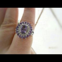 Amethyst Diamond Ring Silver *Lowest price ever this weekend only* Really beautiful ring the stones in this ring are such a beautiful shade of purple.  Center stone is 1.00ct. Diamonds are 0.02cts. Platinum over 925 silver. TGW is 2.12cts. Has just been sitting in my jewelry box, never worn. Jewelry Rings