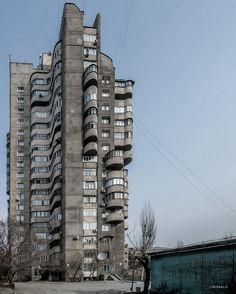 18-storey Housing Building, Bishkek (formerly Frunze), Kyrgyzstan. Built 1985. Architects: B. Lebedev, I. Kombarbayev, A. Nezhurin, M. Baybekov, Ya. Grinshtein. Photo by Dumitru Rusu. Image © BACU
