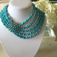 """16"""" Beautiful Layered Beaded Necklace Purchased from SAKS, this necklace is 16"""" shortest strand and 19"""" longest strand. Beautiful turquoise beads with statement piece to the side made of crystals and gold. Great for casual and dressy. SAKS FIFTH AVENUE Jewelry Necklaces"""
