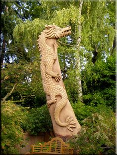 Fantastic wood carving on a dying tree. Wood carver - Stanley Rill