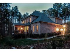 This beautiful, custom-built home is tucked away in a natural setting with plenty of space.