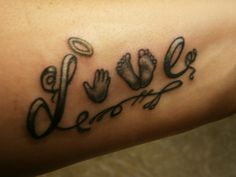 Our baby's foot and hand print within the word LOVE, tattoo'd on my left forearm... Late miscarriage