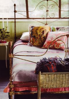 Boho Bedroom - great colors and fabrics. Like the rusty bedframe