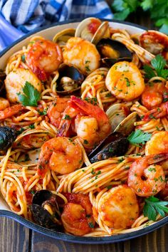 This seafood pasta is a mix of shrimp, clams, mussels and scallops, all tossed together with spaghetti in a homemade tomato sauce. Pastas Recipes, Seafood Pasta Recipes, Dinner Recipes, Seafood Marinara Pasta, Pasta With Seafood, Spaghetti Marinara Recipe, Clam Recipes, Recipe Pasta, Sausage Recipes