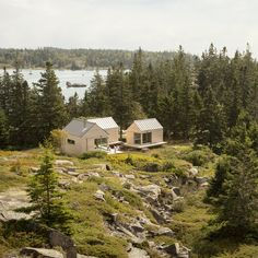 Trio of wooden cabins forms Little House on the Ferry in rural Maine, by Go Logic