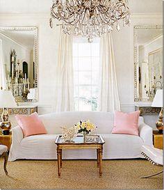 Adorable color scheme for spring! I now want a white home with pink pillows.    via cotedetexas.blogspot.com