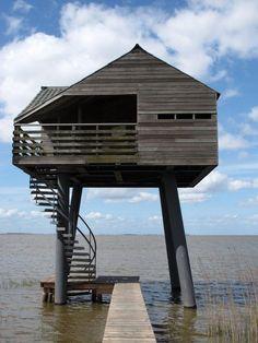 Kiekkaaste, Dollard, Netherlands.  Wood house on stilts.
