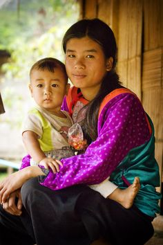 Mother and child . Hill Tribe Village . Thailand